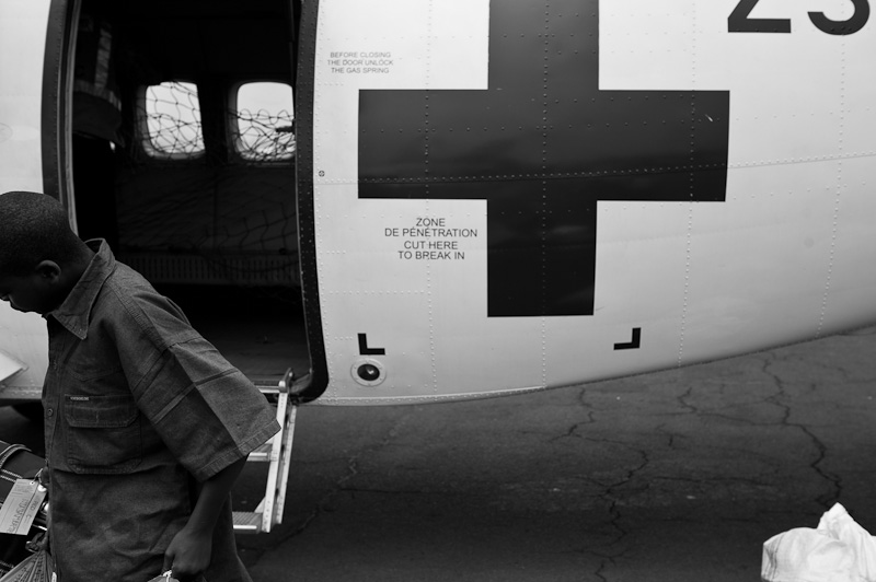 An ex-child soldier arrives at Goma airport on an International Committee of the Red Cross aeroplane following his demobilisation.