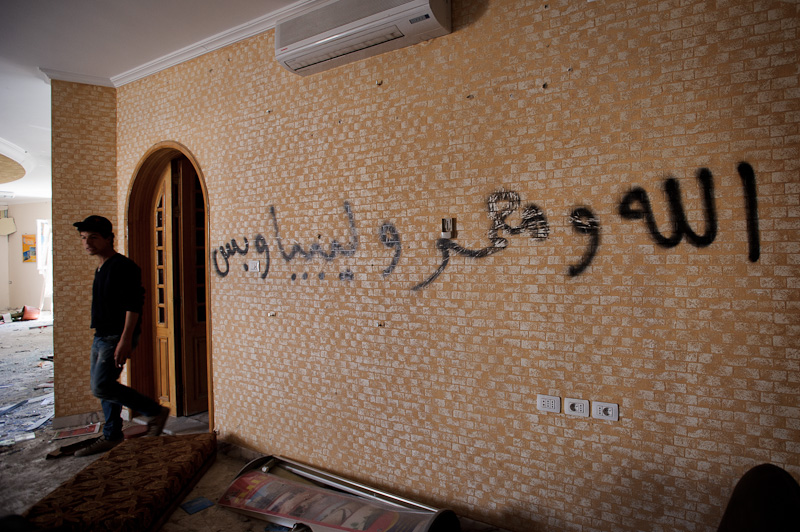"""God and Muammar [Qaddafi] and Libya, and that's all"" Graffiti scrawled on the wall of a building in Misrata just captured by rebel fighters from Qaddafi troops."