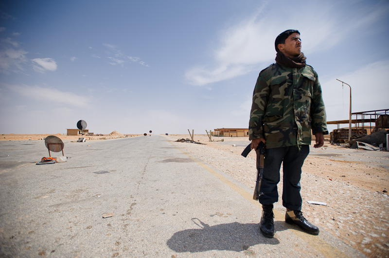 Traveling back into Libya. An armed soldier mans the Tobruk - Ajdabiya desert highway. Yesterday, Ajdabiya was re-taken from Qaddafi loyalists by rebel fighters. I couldn't help but remember that this was the same road where a good friend of mine was kidnapped by the loyalists just a week previously.