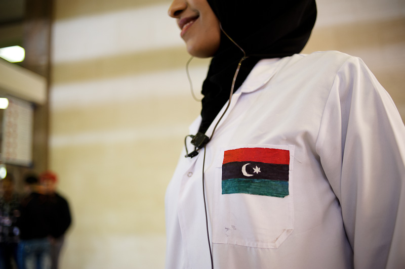 The flag of the revolution is everywhere. Libyan nurse at the Benghazi Medical Centre.
