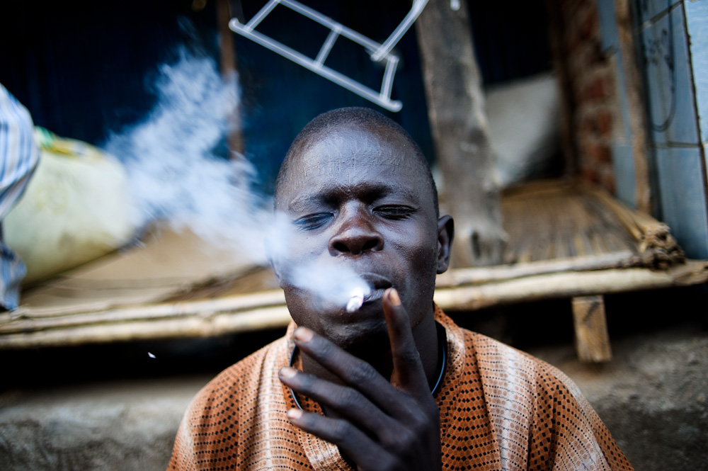 A young Nuer smoking at Konyo Konyo market, Juba.    In one month's time, Nuer, Dinka and all the other tribes of Southern Sudan will be voting to determine whether Southern Sudan will secede from the north. The place has a long way to go to become an autonomous, functioning nation.
