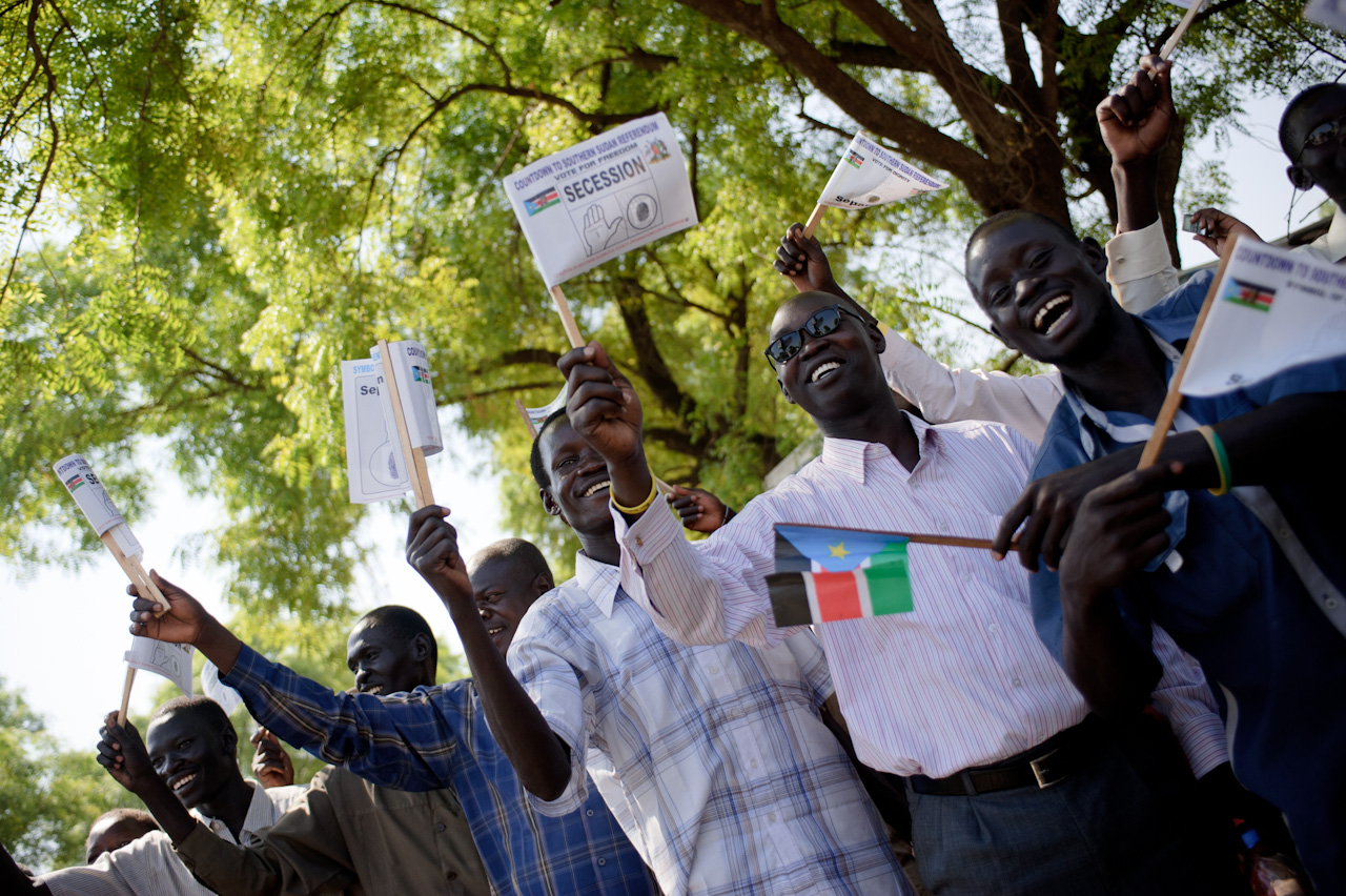 "Omar al-Bashir in Juba    ""Bye bye Bashir"" people chanted as Sudan's president, Omar al-Bashir, sped past them in a massive motorcade. Upon the roundabout around which they had congregated, a clock stands, counting-down to the Southern Sudan referendum. Today, it was showing four days.    Despite their chant and the flags they waved which ubiquitously called for secession, with the open palm symbol meaning ""separation"", the Southern Sudanese citizens claimed no animosity towards al-Bashir. ""We are very happy to see the president here. Southerners have no problem with northerners"" said Joseph Mairi from Eastern Equatoria. Banners by the side of the road from the airport greeted al-Bashir, but reminded him that his time as president would soon be over. ""We welcome you back to celebrate the independence of south Sudan"" read one, erected by a non-governmental civil group.    His visit was one of conciliation, meeting Southern president Salva Kiir, stating that the North would accept the result of the referendum, whether for unity or secession, and that they would help the South post-referendum. ""I am going to celebrate your decision, even if your decision is secession"" he said.    During recent weeks, the north has made several attempts to convince Southerners to vote for unity, but the feeling here on the street is that it is too little, too late. ""What did they offer for the last fifty-five years?"" asks Akol Hem Arop, a doctor working in Juba. ""We have four days to decide for the future of our people. These four days will not be like the hell of the 50 years of unity. We have to decide at the ballot box. My child will have a better future. He will not be a second class citizen."""