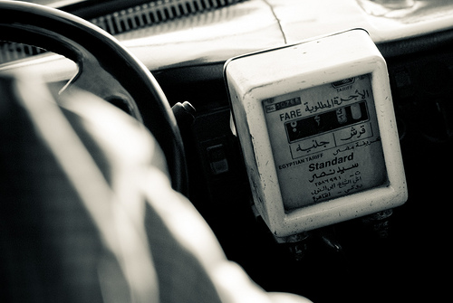 Cairo Transport: Taxis    The meters in the old,  black cabs  of Cairo are obsolete. Calibrated in a time before a sharp rise in petrol prices, they are just ornaments for the vehicle, and somewhat of a design icon for people like me.    At first, as a foreigner, haggling is a necessity before opening the door; we have an inherent fear of taxi-drivers the world-over. But as one gets to know the place, and more importantly the prices, it is possible to adopt the Egyptian method: name the destination & get-in. Knowledge of the fare is implicit, and upon reaching the final-point, handing over the correct sum with a  shukran , and a  ma salama  is all that is required. Talking money is a nasty business.