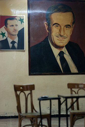 Waltz with Bashar (ii)    On the wall in a café in Damascus.    I'm revising my thoughts about  his  popularity, and the symbolism of his omnipresence. Although I don't feel at liberty to say so. Erm, literally.
