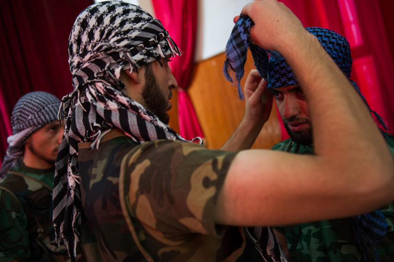 "Members of  Ibn Walid  tie their  keffiyeh  ahead of the group's ""launch"" video"