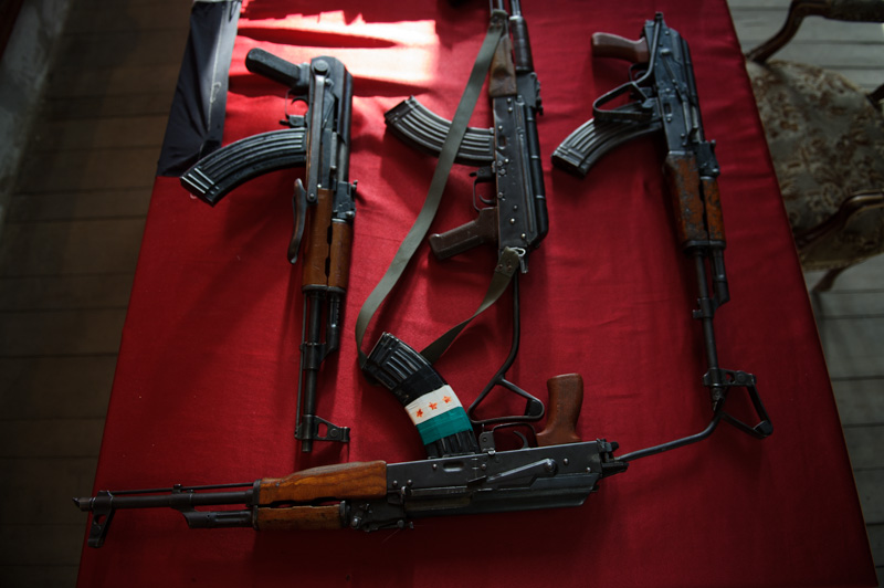 "AK-47s belonging to soon-to-be fighters of  Ibn Walid  sit on a table following the filming of the group's ""launch"" video"