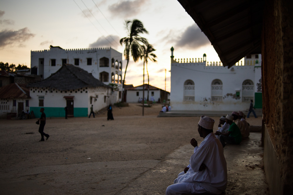Lamu muslims sit outside the old mosque in the town.