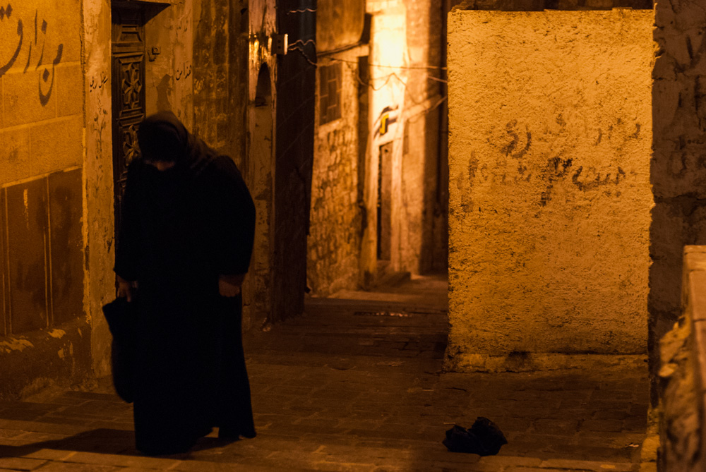 A woman walks through the streets of the Old City. October 2009.