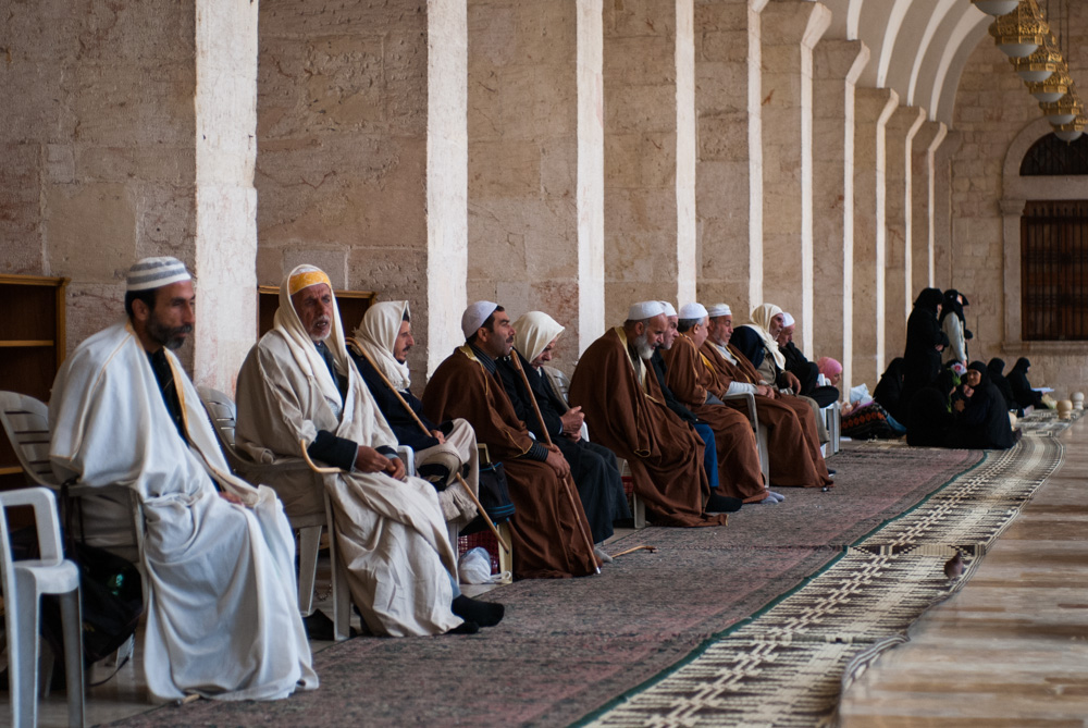 """Men sit in the Umayyad—or """"Great""""—Mosque in Aleppo. November 2009."""