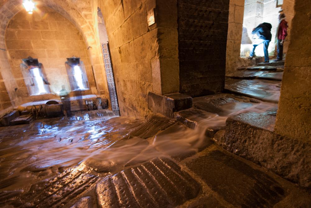 Rain streams through the alleys of the Citadel in Aleppo. November 2009.