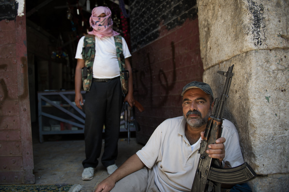 Nowadays, the only people posing in the Old City are rebel fighters. August 2012.