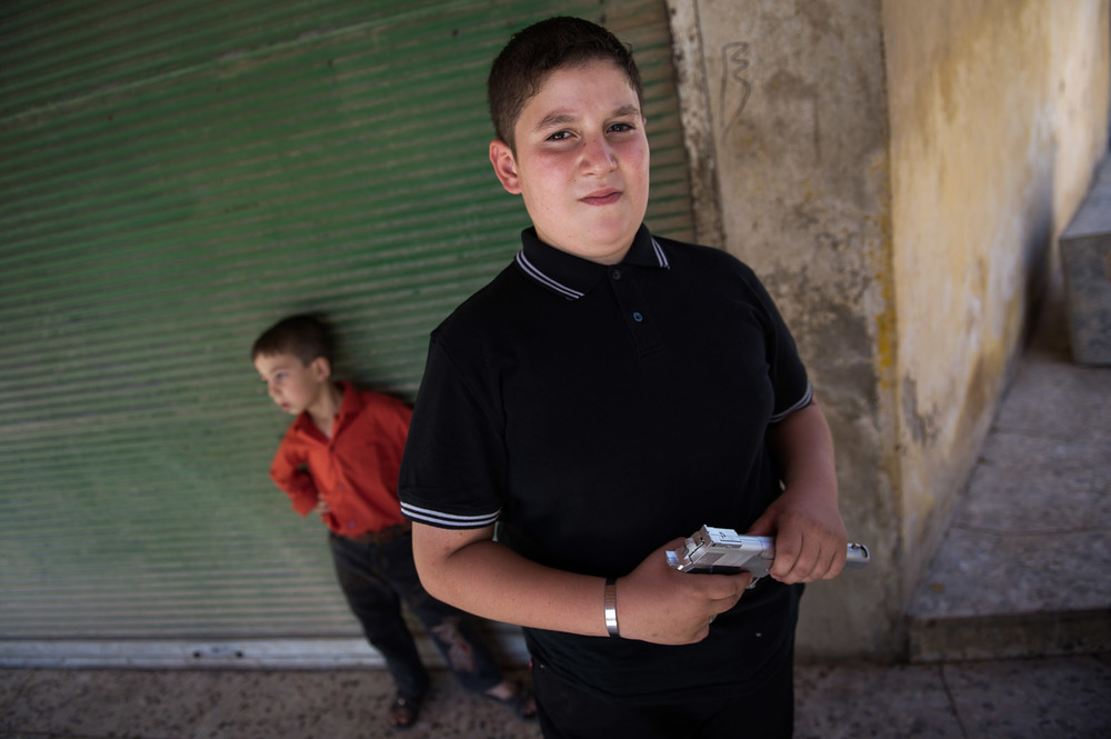 A child celebrates the end of Ramadan with a toy gun in northern Syria