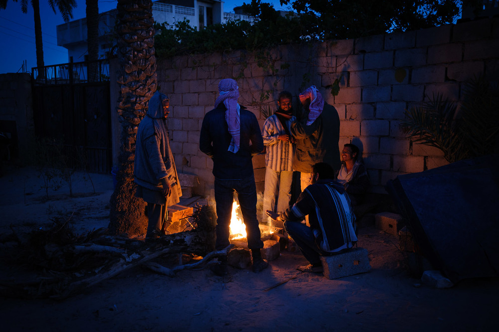 Rebels man a checkpoint at dusk in Misrata, mid-April 2011. It would take them over five months to finish their revolution, ousting Col. Ghaddafi from Tripoli and eventually killing him in his birth-town of Sirte.