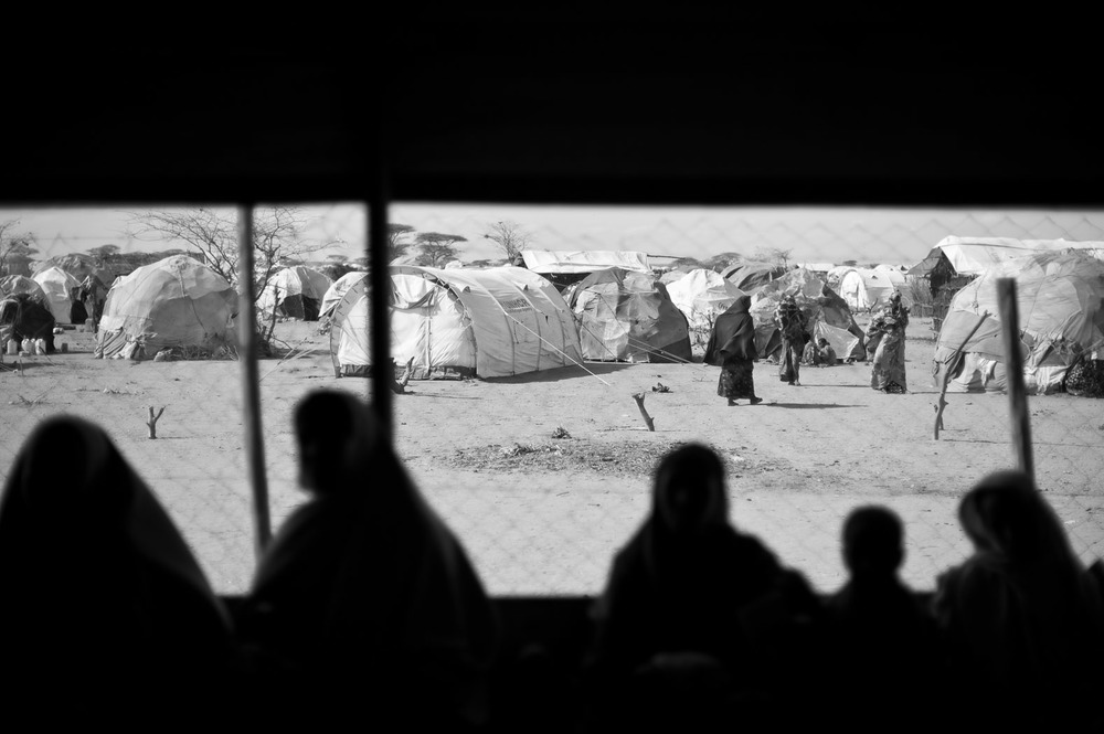Mothers wait at a Médicins Sans Frontières (Doctors Without Borders) health outpost on the outskirts of Dagahaley Refugee Camp.