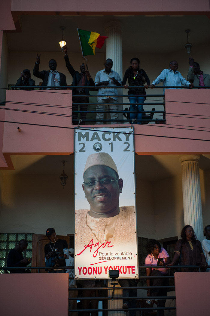 As results trickled in, indicating a win for Sall, increasing numbers of people gathered outside the headquarters.