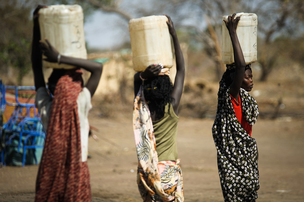 Hopes were high for this new nation, with people continuing to arrive well after the referendum. Here, a group of women fetch water in a settlement just outside the town of Aweil in Northern Bahr el-Ghazal state.  Aid workers here expect there to be tens of thousands of people living in this area by the end of the year; an area that just a few months ago was completely uninhabited. The demands for jobs, land and resources will be massive.