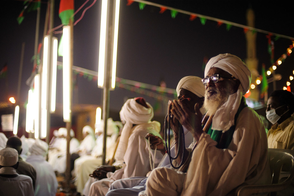 Sufis sit during a recital of stories of the life of the Prophet Mohamed during  Mawlid  celebrations in Khartoum, Sudan.