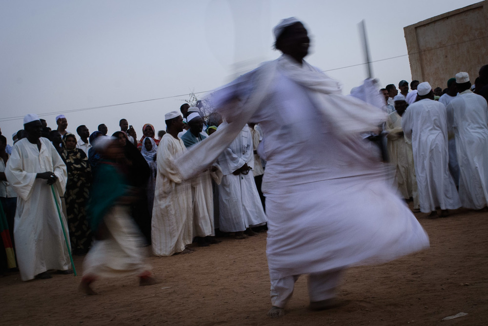 Sudanese sufis dance during a Friday congregation at the Hamid el-Nil mosque.