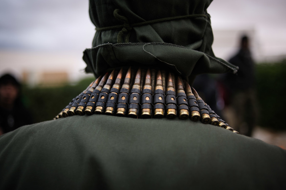 Belts of ammunition adorned the necks, shoulders and waists of many Libyan men.