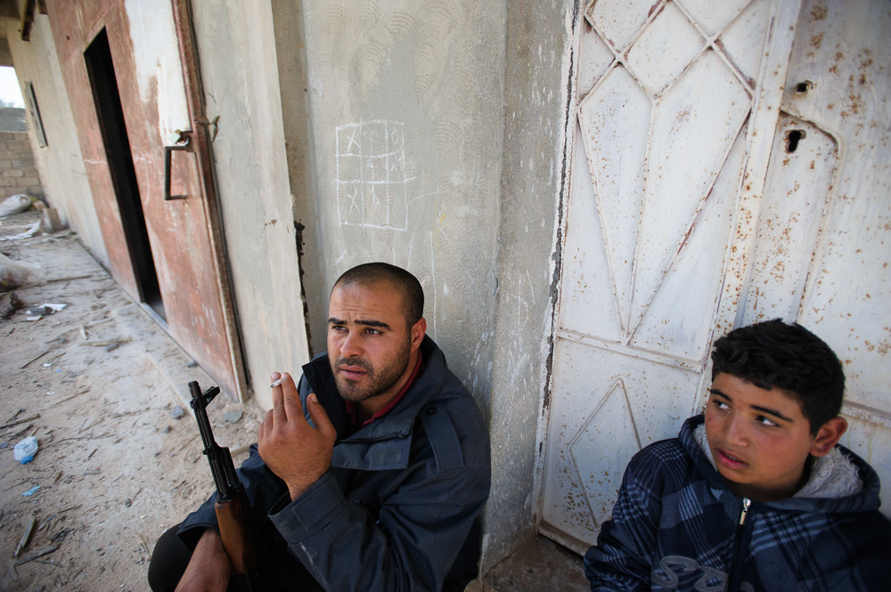 Neighbourhood watch: a man and his son guard their neighbourhood as fighting rages in Misrata.