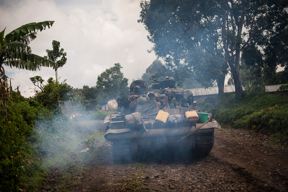 Congolese army soldiers advance towards Bunagana aboard a tank