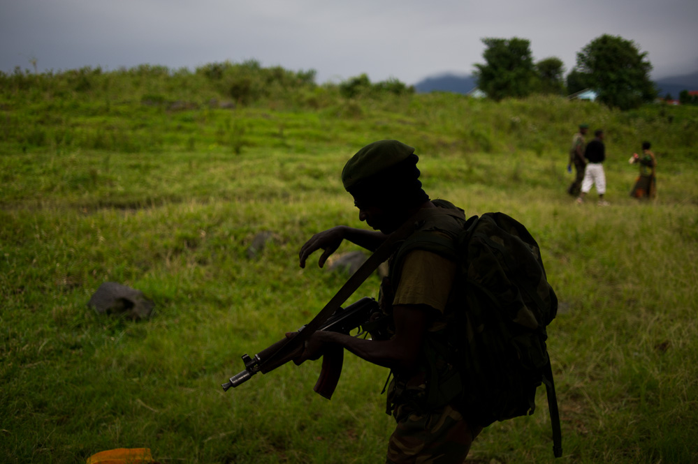 FARDC soldier walks through the recaptured Rumangabo military academy