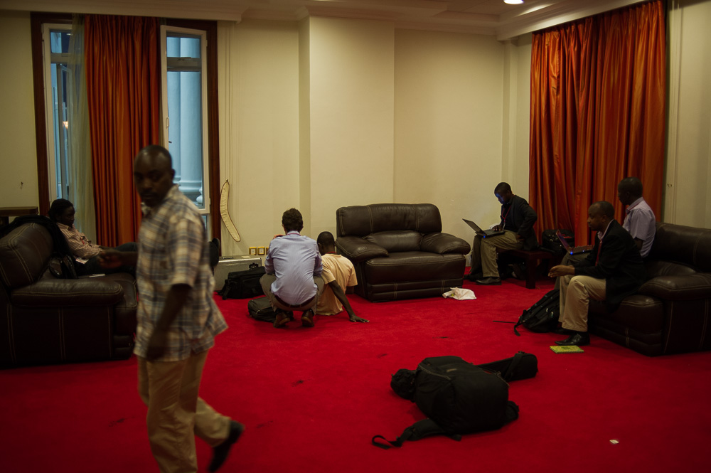 "Journalists sit in the ""holding room"", waiting for the peace accord"