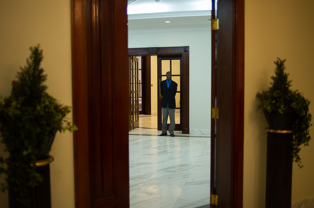 State House security man the corridor leading to the negotiating room