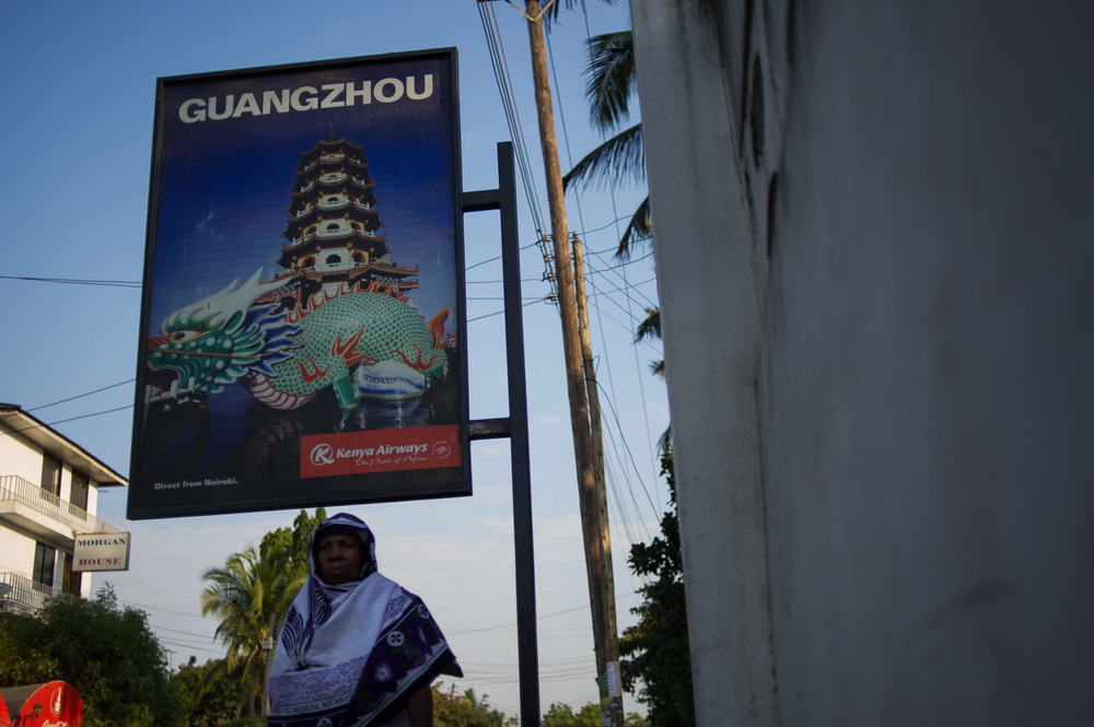 An advertisement for flights to Guangzhou by Kenya Airways stands in the streets of Dar es-Salaam. Guangzhou is China's main ivory-carving-and-trading center.