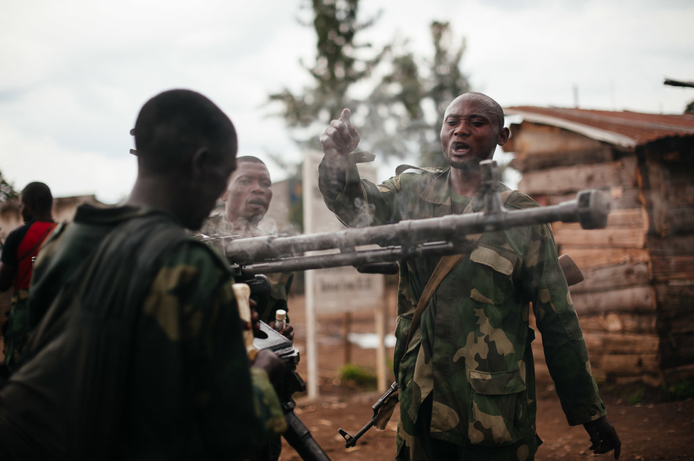 Congolese army soldiers rearm a .50 calibre machine gun on the outskirts of Bunagana, the last bastion of the rebels.