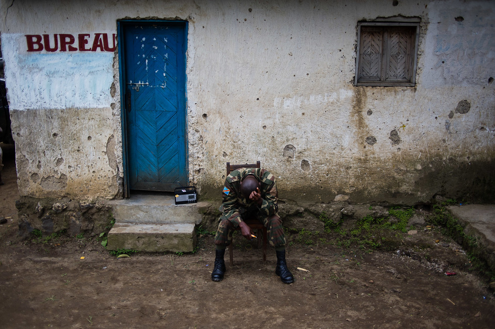 A Congolese army officer rests at a village in territory recently liberated from the rebels.