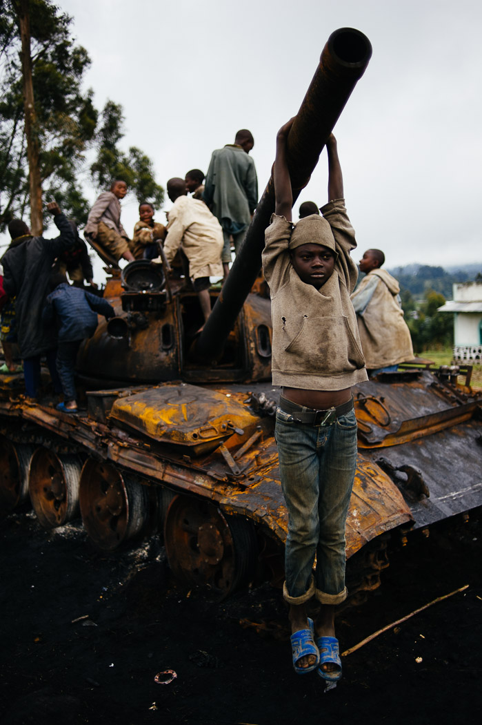 Congolese children play on a destroyed tank used by M23 forces in Kibumba. Children here have grown up with conflict, and this marks an end of just one of myriad armed groups operating in the region.