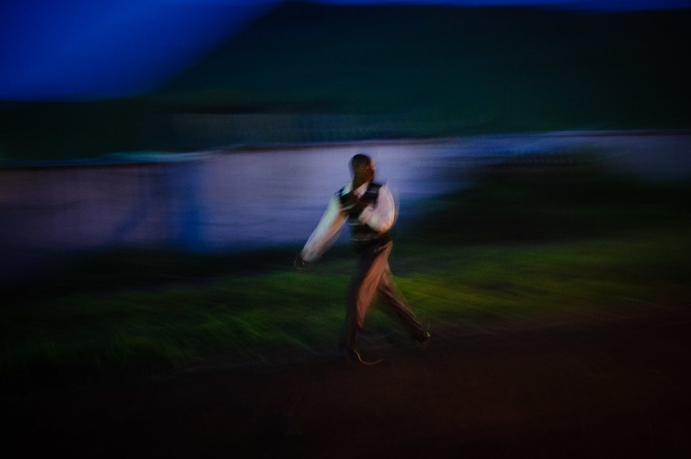 A man walks past the United Nations base at Monigi, on the outskirts of Goma