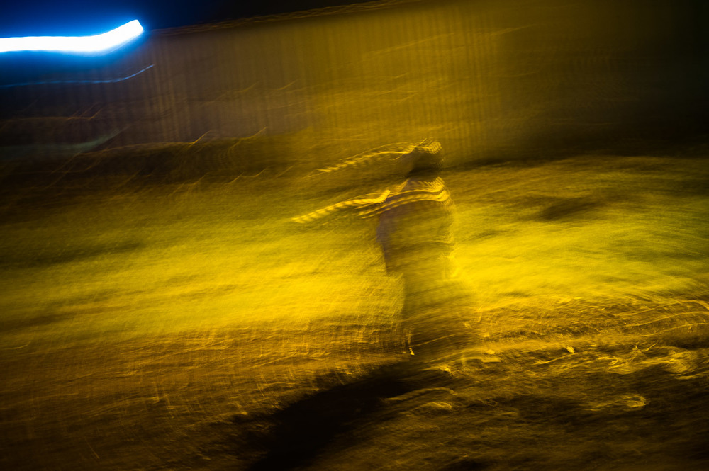 A woman walks near the United Nations base in Monigi, on the outskirts of Goma