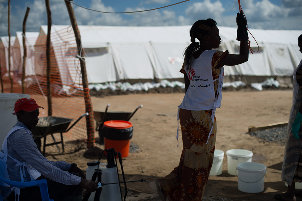 An MSF worker has her shoes sprayed as she moves between sections of the cholera treatment centre in Gudele