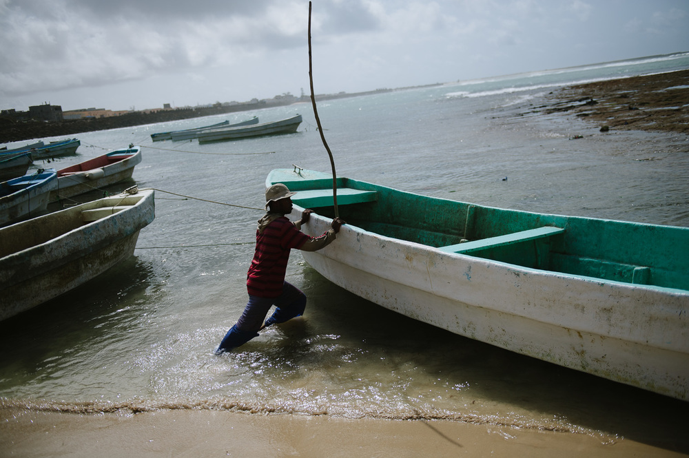 A man prepares a boat in the old harbour