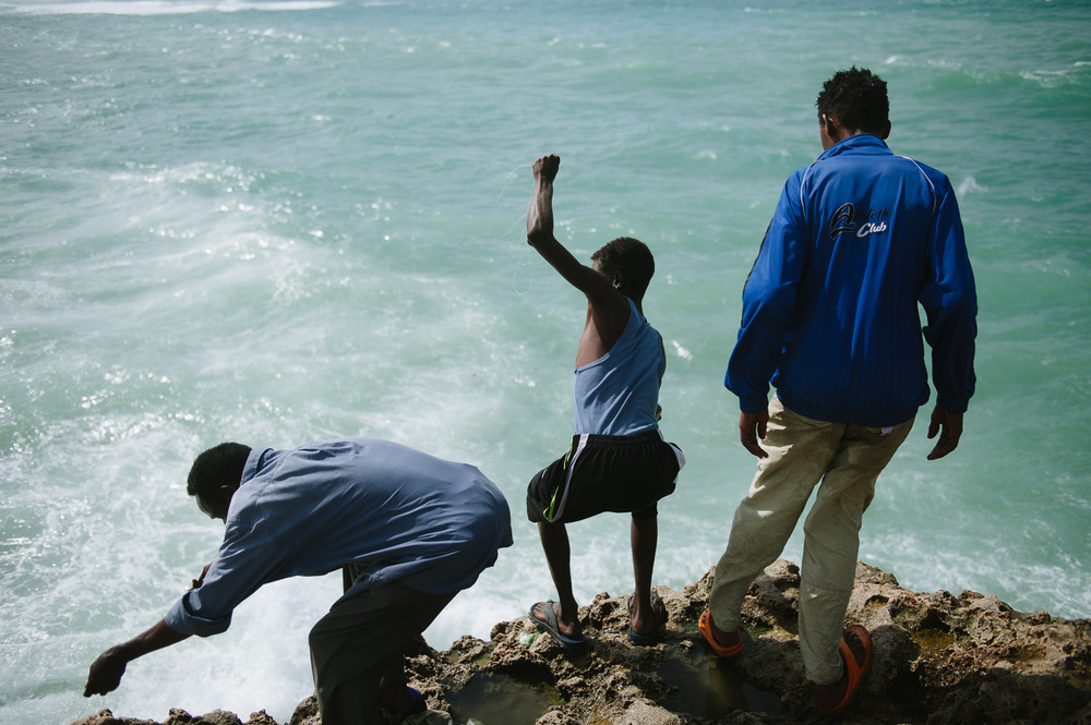 Men cast lines for fish near Mogadishu's old port.