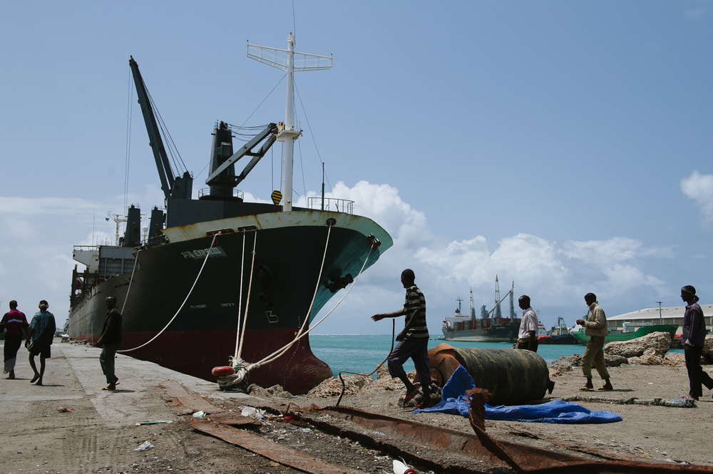Workers walk through Mogadishu's port