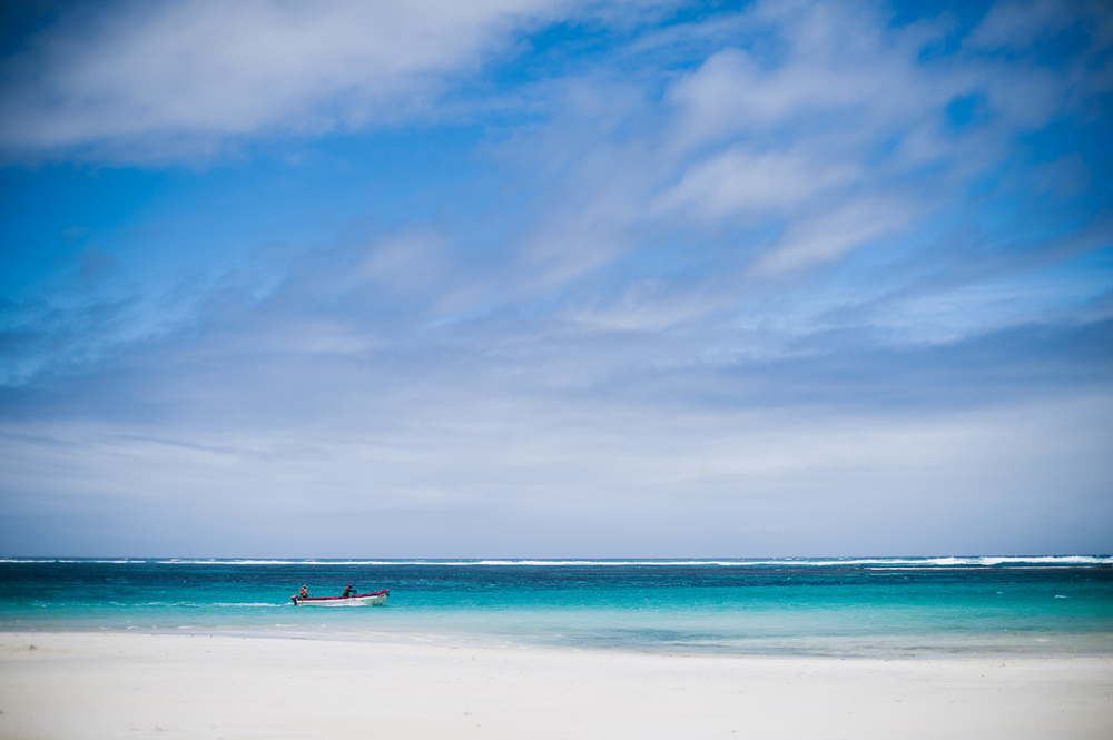 A boat passes along the white sands of the Lido beach in Mogadishu.