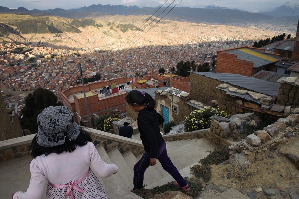 Young girls walk through a poor neighbourhood in the city of El Alto, overlooking the Bolivian capital of La Paz.
