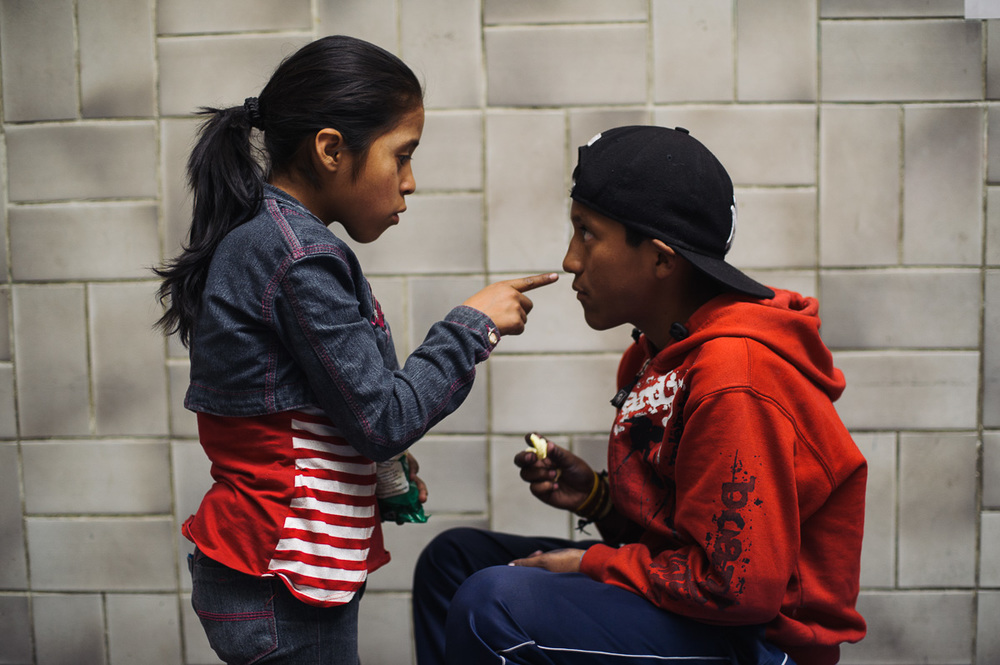 Edith (10) tells off her brother, Ruben (13), at their home at a centre for shoe-shiners in La Paz, Bolivia, on November 29, 2014. Ruben is the only one of his four siblings who works, and helps to support the family.