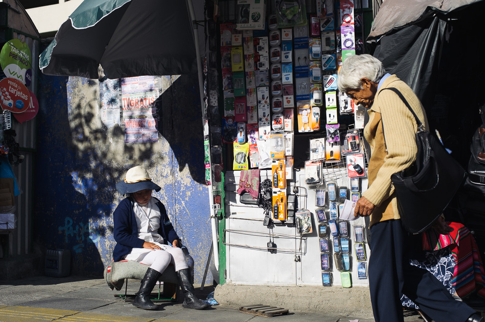 A young girl works on a street-side stall selling mobile-phone accessories in La Paz, Bolivia.