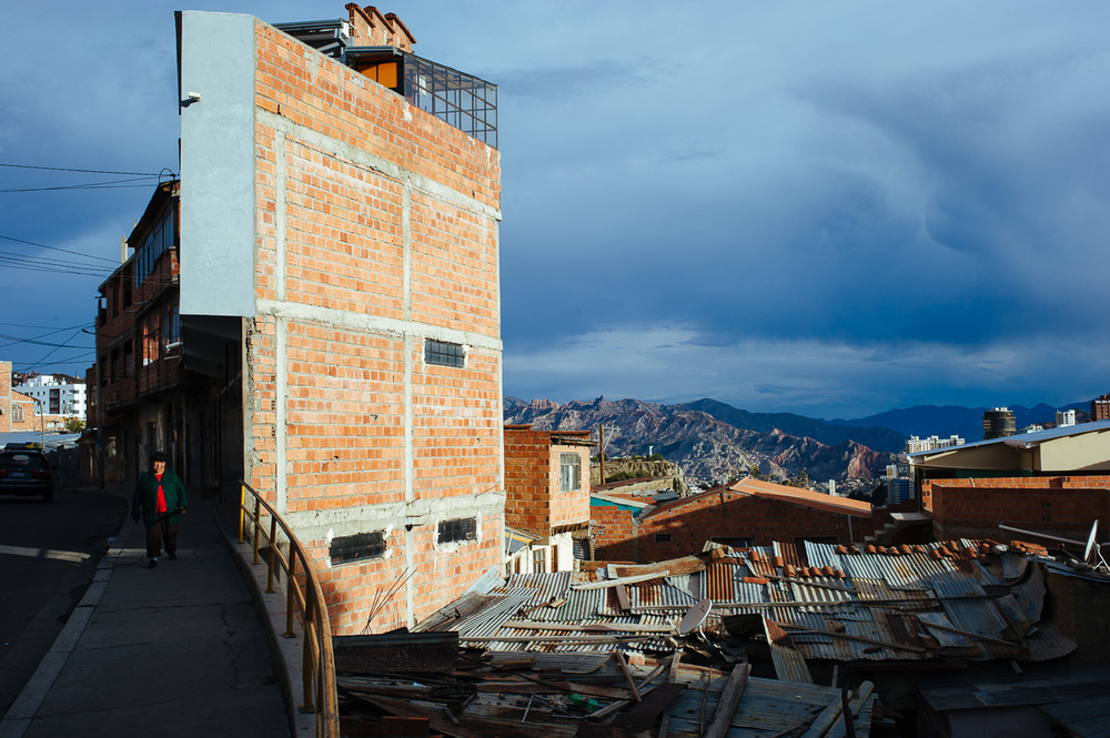 A lady walks down a street in a poor area of La Paz, Bolivia.