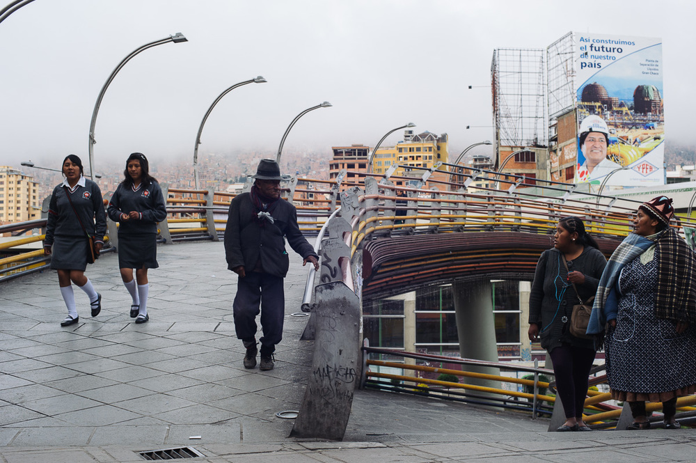 """Schoolgirls walk to school in the early morning in La Paz, Bolivia. """"In Bolivia, there are two societies: those who raise their children to have an education and one day become president; and those who raise their children to work to survive"""" says Alex Narvaez, who deals with child workers in the city of El Alto."""