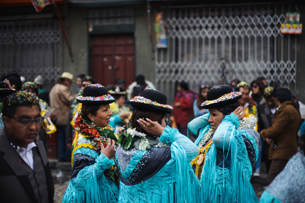 Women dressed in traditional outfits take part in a street-celebration of a saint in a working class neighbourhood of La Paz, Bolivia.