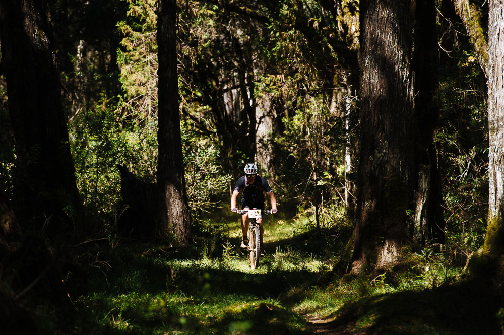 A competitor rides through the incredibly fun Afro-Alpine forest tracks on the slopes of Mount Kenya