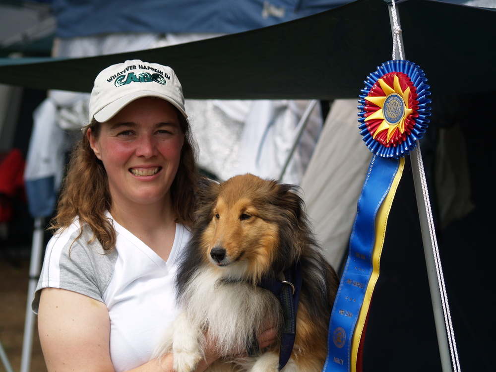 Dawn Wasicek with Whisper, winning a dog agility award for having the most fun and the best team work at the CATS trail in New Hampshire.