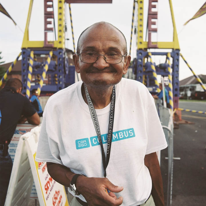 This man made me take his photo. He waited in line, but the ticket taker would not let him ride solo, so he didn't get on.