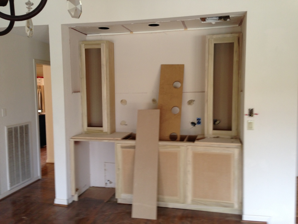 The Bar cabinet is underway. There is still a valance with lighting, mirrors and counter tops to be installed. We are handing the wine refrigerator differently than most. There will be a full panel concealing it rather than a glass door.