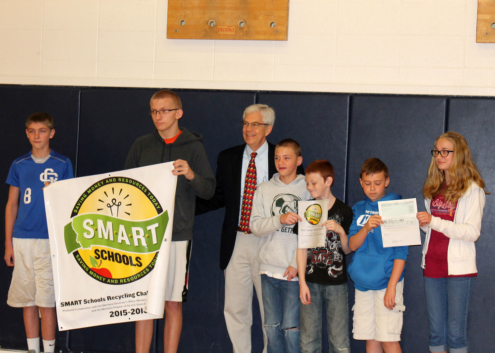 Lt. Governor Mike Cooney congratulates Will James students at an assembly on 4/20/2016. Will James Middle School earned $1000 by recycling over 11,000 pounds of recycling materials this year!
